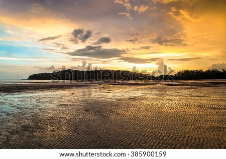Beautiful sunset at beach on Koh Yao Yai island in Thailand. Landscape with tropical sea sunset on the beach. - stock photo