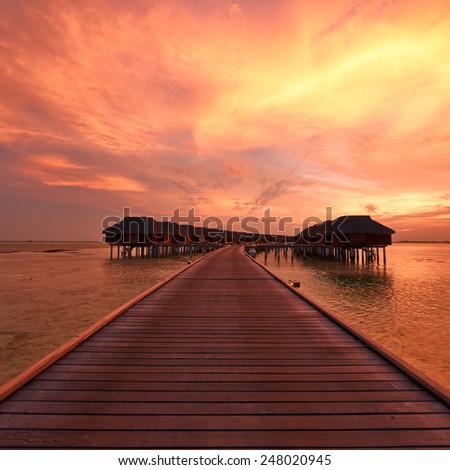Beautiful sunset at Maldivian beach - stock photo