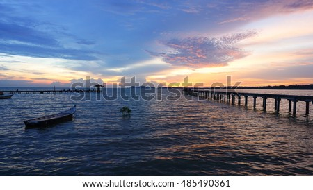 Beautiful sunset at seascape with dramatic clouds sky. Soft focus due to shot at sunset. Composition of nature.