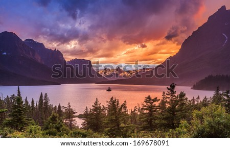 beautiful sunset at St. Mary Lake in Glacier national park  - stock photo