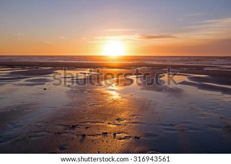 Beautiful sunset at the atlantic ocean - stock photo