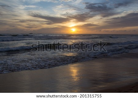 Beautiful sunset at the beach during our holiday in Sri Lanka, Bentota - stock photo