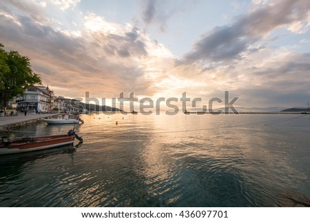 Beautiful sunset at the Port in the Town of Limnas in Thassos, Greece. - stock photo