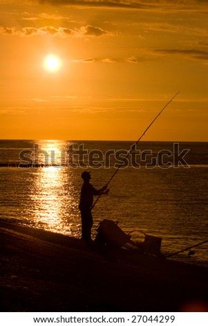 beautiful sunset at the seaside and fisherman