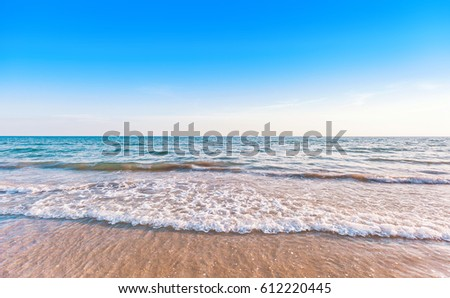 beautiful sunset at the tropical sea with a little waves and blue sky in vacation time