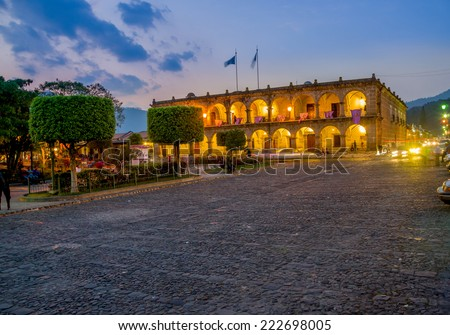 beautiful sunset Baroque building in main square plaza Antigua Guatemala - stock photo