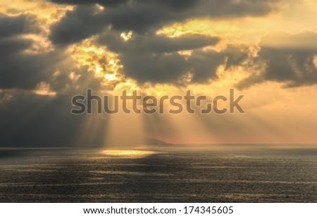 Beautiful sunset beams over the ocean in Puerto Vallarta Mexico - stock photo