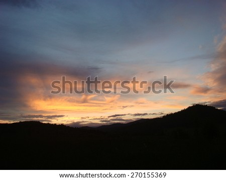 beautiful sunset behind the mountains - stock photo