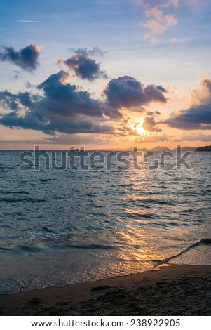 Beautiful sunset behind the ocean - Krabi, Thailand - stock photo