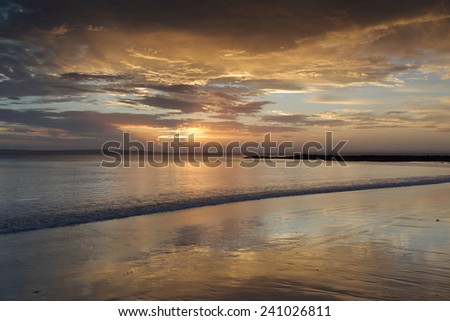 Beautiful sunset colours and peaceful tranquil waters at Cabbage Tree Beach, Jervis Bay Australia - stock photo