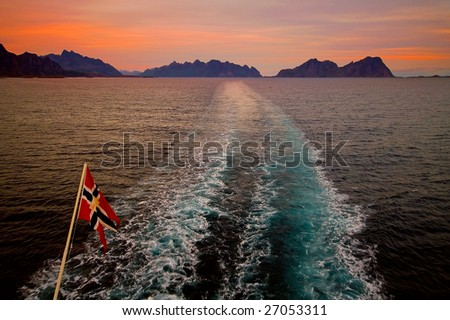 Beautiful sunset during traveling by Norwegian ferry through Lofoten Islands - stock photo