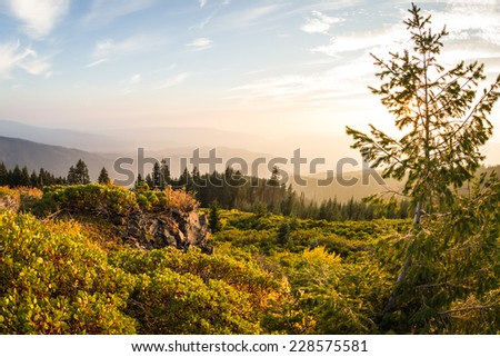 beautiful sunset from the top of Red Blanket Mountain in Oregon, some smoke in the air form forest fires - stock photo