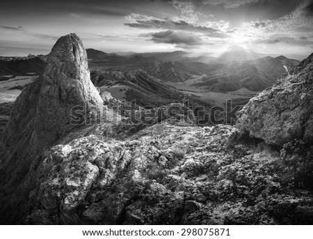 Beautiful sunset in a Crimea mountain valley. Black and white