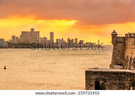 Beautiful sunset in Havana with El Morro castle on the foreground - stock photo