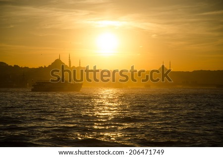 Beautiful sunset in Istanbul Turkey with the city silhouette taken during the Bosphorus cruise - stock photo