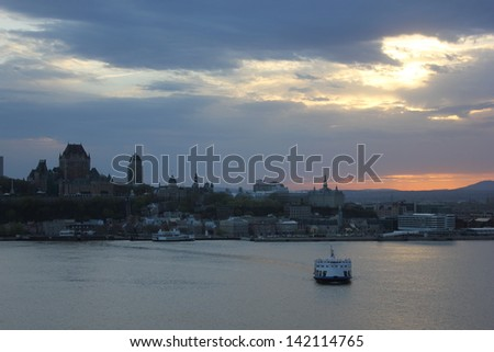 Beautiful sunset in Quebec city from Levis above Saint Lawrence river in a cloudy spring day