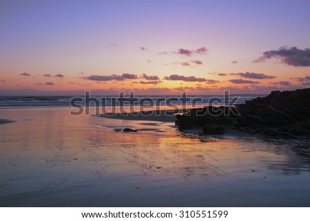 Beautiful sunset in the atlantic ocean - stock photo