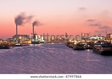 Beautiful sunset in the harbor from Rotterdam in the Netherlands - stock photo