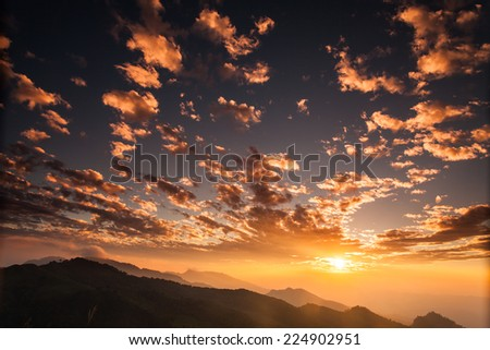 Beautiful sunset landscape in countryside with cloudy sky  - stock photo