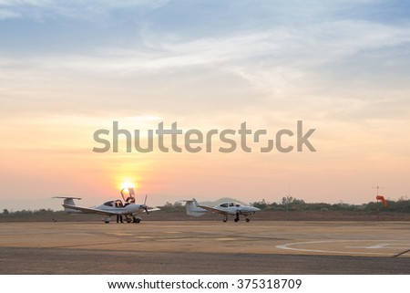 Beautiful Sunset Landscape with Aircraft at Airport,  Twilight Tone