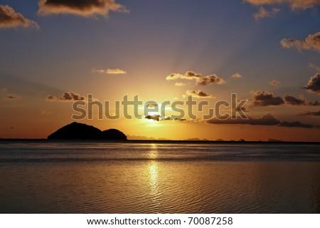 Beautiful sunset on a Thai beach, Ko Pha Ngan. - stock photo