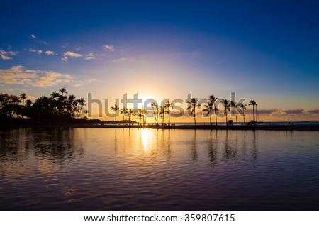 Beautiful sunset on Hawaiian beach, Big Island - stock photo