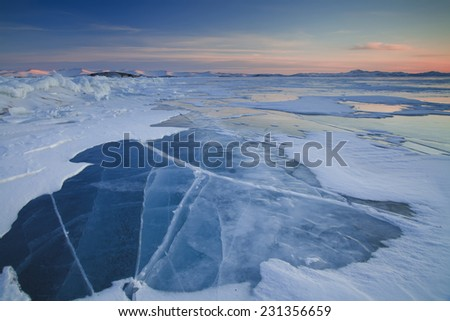Beautiful sunset on icy Lake Baikal - stock photo