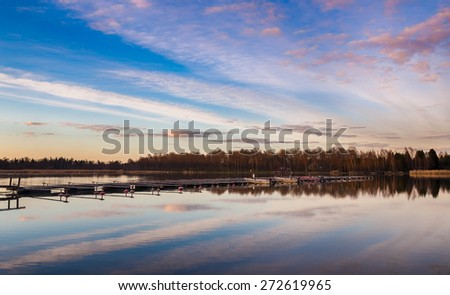 beautiful sunset on sea pier for boats Aland island Finland