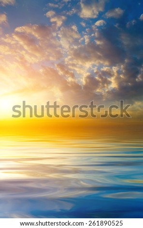 Beautiful sunset on the background of the calm sea. natural composition - stock photo