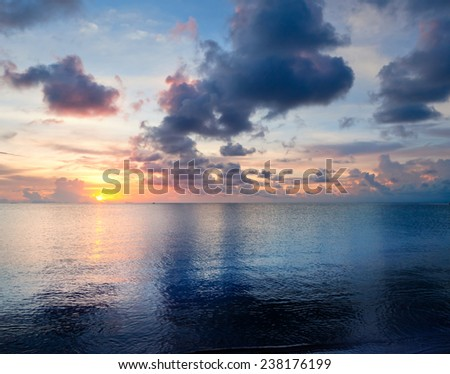 beautiful sunset on the beach - stock photo