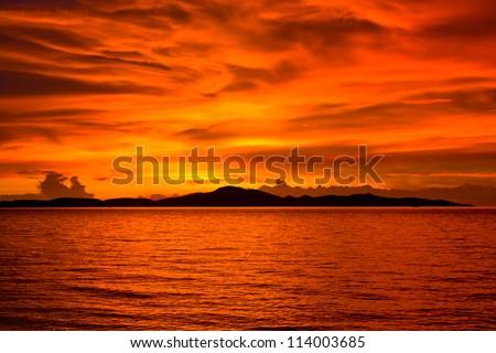 Beautiful sunset on the beach in Pattaya, Thailand. - stock photo