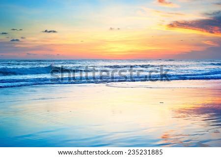 Beautiful sunset on the ocean beach of Bali island, Indonesia - stock photo
