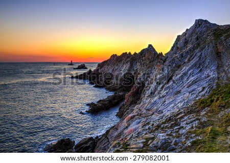 Beautiful sunset on the Pointe du Raz located on Finistere coast in Brittany, north-west of France.This is the France's most westerly point. - stock photo