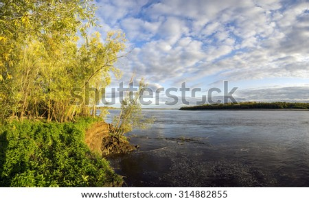 Beautiful sunset on the river Ob in Western Siberia. - stock photo
