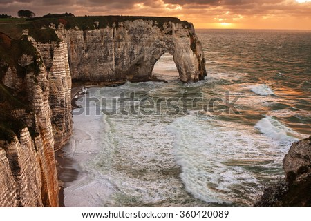 Beautiful sunset on the sea in Etretat, Normandy, France. - stock photo