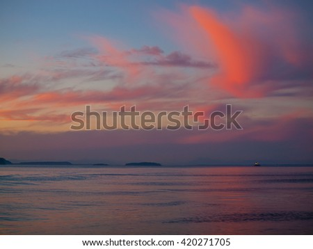 Beautiful Sunset on the Water Traveling on a Boat - stock photo