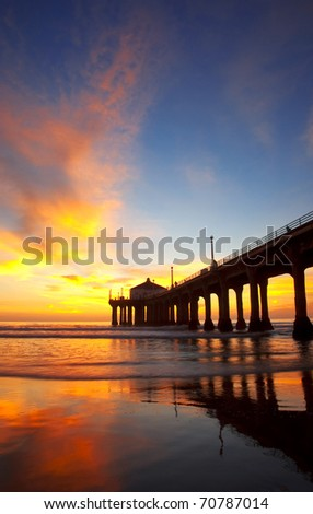 Beautiful sunset over a pier in the city of Los Angeles. - stock photo
