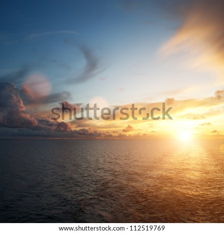 Beautiful sunset over an ocean - stock photo
