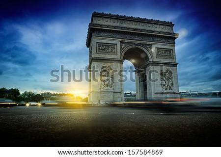 Beautiful sunset over Arc de Triomphe at Place de l'Etoile, Paris - stock photo