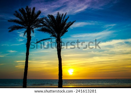 Beautiful sunset over Atlantic Ocean in Agadir, Morocco - stock photo
