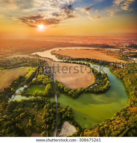 Beautiful sunset over Czech Valley Reservoir in The Litice suburban district of Pilsen.  Aerial view to scenic landscape in Czech Republic, Central Europe. HDR (warm filtered) photography.  - stock photo