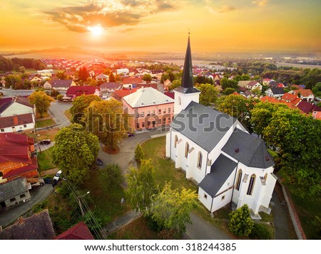 Beautiful sunset over gothic church St. Peter and Paul in The Litice suburb of Pilsen. Aerial view to romantic citiscape in Czech Republic, Central Europe. HDR (warm filtered) photography.  - stock photo