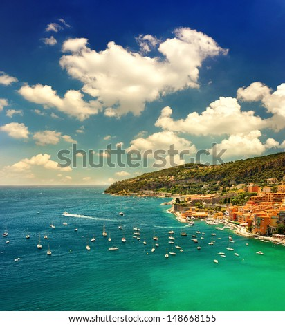 beautiful sunset over mediterranean sea. view of luxury resort and bay of Cote d'Azur. Villefranche by Nice and Monaco, french riviera - stock photo