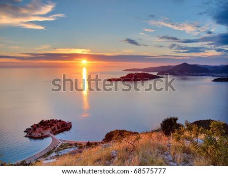 Beautiful sunset over Montenegro coastline. View from the top of mountain - stock photo
