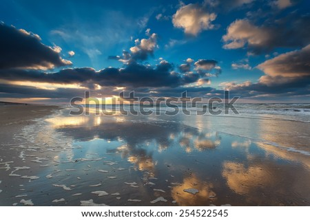 beautiful sunset over North sea coast, Zandvoort, Netherlands - stock photo