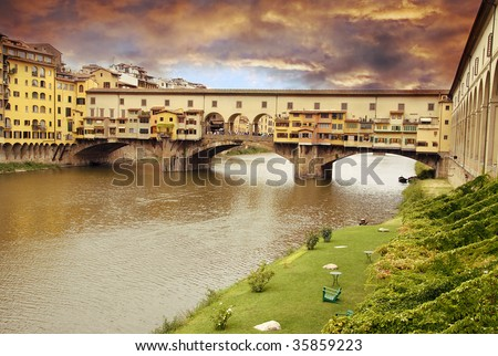 Beautiful sunset over of the oldest bridge over the river Arno in Florence Ponte Vecchio