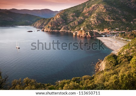 Beautiful sunset over Porto city, Corsica - France - stock photo