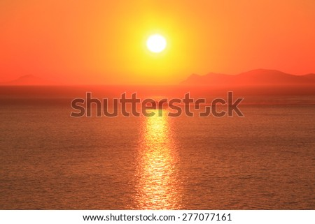 Beautiful sunset over Santorini caldera with boat, Santorini island, Greece - stock photo