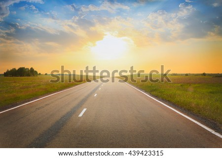 beautiful sunset over the country highway - stock photo