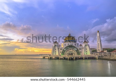 Beautiful sunset over the majestic mosque, Malacca Straits Mosque (Masjid Selat). Soft focus due to slow shutter shot.